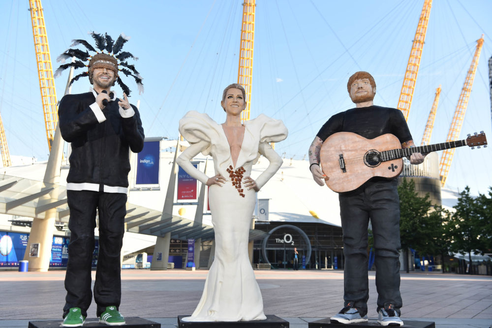 EMBARGOED TO 0001 MONDAY JUNE 19 EDITORIAL USE ONLY Three life-size cake statues of Jamiroquai, Celine Dion and Ed Sheeran, which food artist Lara Mason was commissioned to create by O2 in celebration of The O2Õs 10th birthday, arrive in Greenwich, London. PRESS ASSOCIATION Photo. Issue date: Monday June 19, 2017. The edible cakes of Ginger Br-Ed Sheeran, Praline Dion and JAM-iroquai will be on display as each of their real-life counterpartÕs play a one-off show in celebration of live music at the venue. Photo credit should read: Matt Crossick/PA Wire